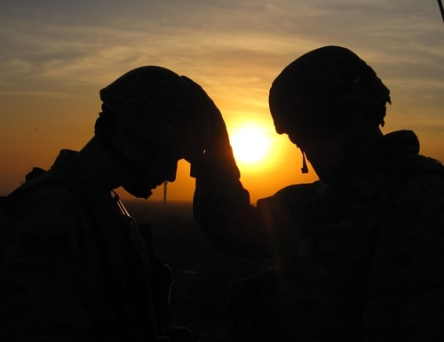 A chaplain provides spiritual guidance to a Joint Expeditionary Tasked airman in a combat zone in Iraq in 2009.