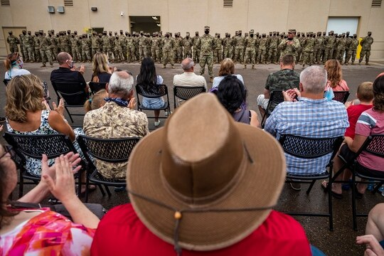 Col. Brian Pfarr, far right, addresses the approximately 150 soldiers from the Stillwater-based 34th Military Police Company who will deploy to Naval Station Guantanamo Bay in support of Joint Task Force Guantanamo to provide base security Sunday, Aug. 9, 2020. (Richard Tsong-Taatarii/Star Tribune via AP)