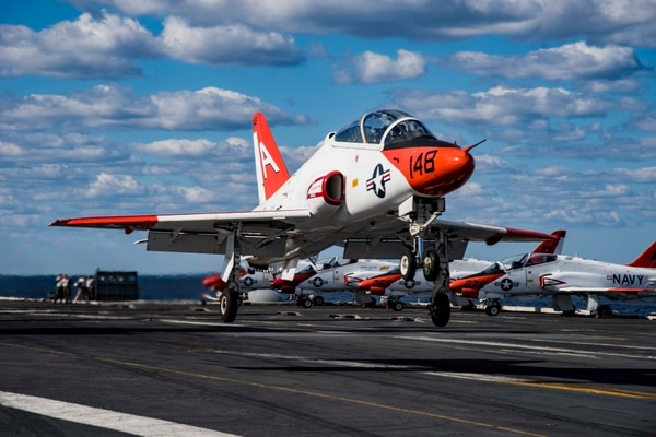 A T-45C Goshawk assigned to Carrier Training Wing 1 in 2017 performs a touch-and-go on the flight deck of the aircraft carrier Dwight D. Eisenhower while Ike was underway in the Atlantic Ocean. (Navy)