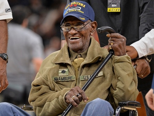 In this March 23, 2017, file photo, Richard Overton leaves the court after a special presentation honoring him as the oldest living American war veteran, during a timeout in an NBA basketball game between the Memphis Grizzlies and the San Antonio Spurs. The Army veteran died Dec. 27, 2018, at a rehab facility in Austin. (Darren Abate/AP)