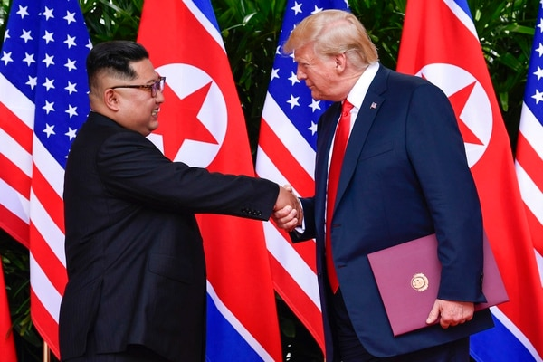 In this June 12, 2018, file photo, North Korea leader Kim Jong Un, left, and U.S. President Donald Trump shake hands at the conclusion of their meetings at the Capella resort on Sentosa Island in Singapore. (Susan Walsh/Pool photo via AP)
