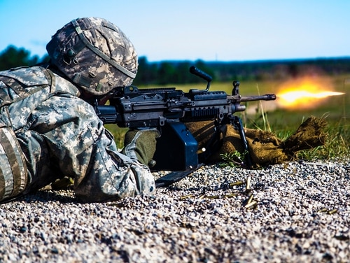 A Michigan National Guard Soldier fires the M249 squad automatic weapon during a live fire exercise. (Spc. Alan Prince/Army)