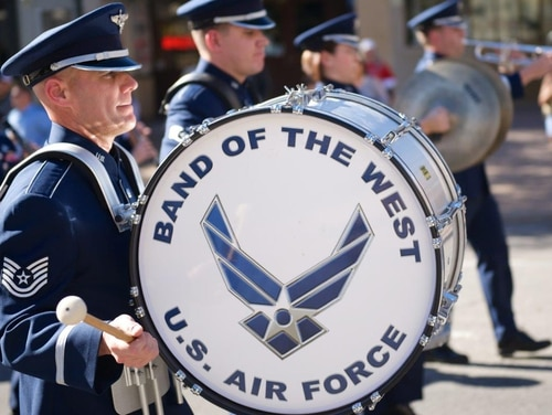 Tech. Sgt. Chuck Lawyer plays the drum while marching with the U.S. Air Force Band of the West's Ceremonial Band during the Governor's Inaugural parade Jan. 20, 2015, in Austin, Texas. (Courtesy photo)