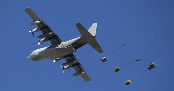 A KC-130T from Marine Aerial Refueler Transport Squadron 452 drops cargo as part of container delivery system training at a drop zone on Camp Lejeune, N.C., Feb. 22, 2018. The training simulated transporting supplies, vehicles and Marines to a designated area. (Lance Cpl. Ashley McLaughlin/Marine Corps)