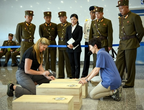 A 2018 remains return to U.S. and South Korean scientists by North Korea shows Drs. Debra Prince-Zinni, left, and Jennie Jin, forensic anthropologists with the Defense POW/MIA Accounting Agency (DPAA), secure a case containing the possible remains of service members lost in the Korean War. Some of those remains have now been verified as South Korean in origin and are being repatriated. (Sgt. 1st Class David J. Marshall/Army)