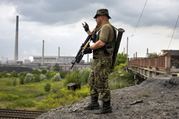Ukrainian serviceman patrol near the chemical plant in Avdeevka, Donetsk region, on June 20, 2015. Russia on June 20 slammed the EU's extension of sanctions over its annexation of Crimea as