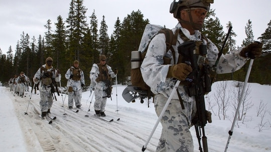 Marines and Sailors with Marine Rotational Force-Europe 18.1 ski toward their live-fire squad attack positions during a winter warfare training exercise at Haltdalen Training Center, Norway, April 18, 2018. (Gunnery Sgt. Clinton Firstbrook/Marine Corps)