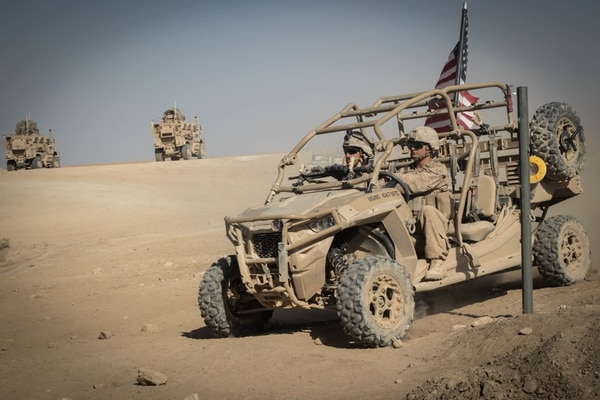 U.S. Marines with 3rd Battalion, 7th Marine Regiment, 1st Marine Division attached to Special Purpose Marine Air-Ground Task Force, Crisis Response-Central Command (SPMAGTF-CR-CC) drive a Utility Task Vehicle around security positions at Fire Base Um Jorais (FB UJ) July 4, 2018. (Cpl. Carlos Lopez/Marine Corps)