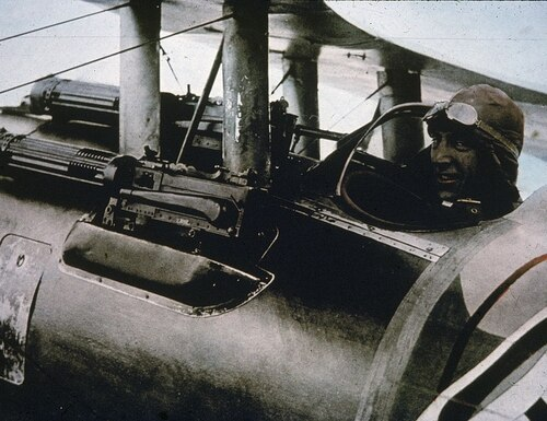 American flying ace Eddie Rickenbacker (1890 - 1973) sits in his Nieuport 28 fighter plane and smiles at the camera, 1910s. Dubbed America's 'Ace of Aces,' Rickenbacker had 26 victories in battle and was part of the first all-American air unit to see combat duty in World War I, the 94th Aero Pursuit Squadron. In this shot, great detail of the plane's armament can be seen. (Photo by Hulton Archive/Getty Images)