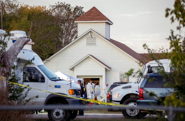 In this Nov. 5, 2017, file photo, investigators work at the scene of a deadly shooting at the First Baptist Church in Sutherland Springs, Texas. (Jay Janner/The San Antonio Express-News via AP, File)