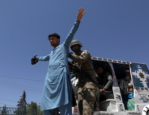 Afghan security police search a man at a checkpoint in Jalalabad, Afghanistan, on April 21, 2021. (Rahmat Gul/AP)