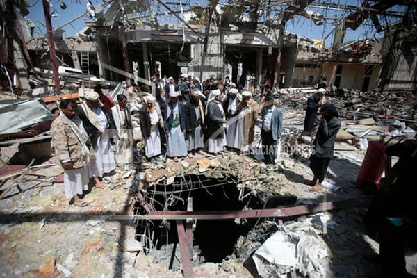 In this Oct. 13, 2016, file photo, members of the Higher Council for Civilian Community Organization inspect a destroyed funeral hall as they protest against a deadly Saudi-led airstrike on a funeral hall six days ago, in Sanaa, Yemen. (Hani Mohammed/AP)