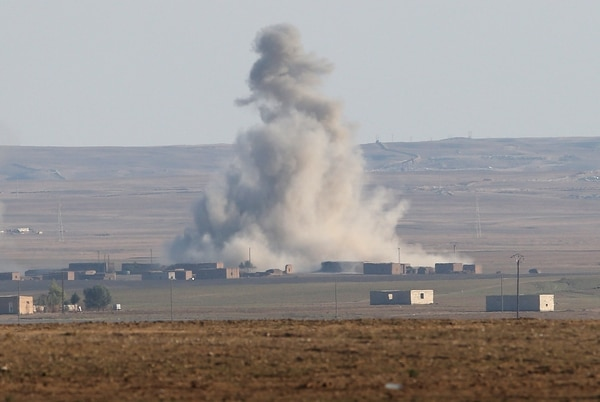 HOLE, SYRIA - NOVEMBER 10: An airstrike by a U.S. led coaltion warplane explodes on an ISIL position on November 10, 2015 near the town of Hole, Rojava, Syria. Troops from the Syrian Democratic Forces, a coalition of Kurdish and Arab units, are attacking ISIL extremists in the area near the Iraqi border. The predominantly Kurdish region of Rojava in northern Syria has become a bulwark against the Islamic State. Their armed forces, with the aid of U.S. airstrikes and weapons, have been battling ISIL, who had earlier captured much of the Kurdish region from the Syrian regime. (Photo by John Moore/Getty Images)