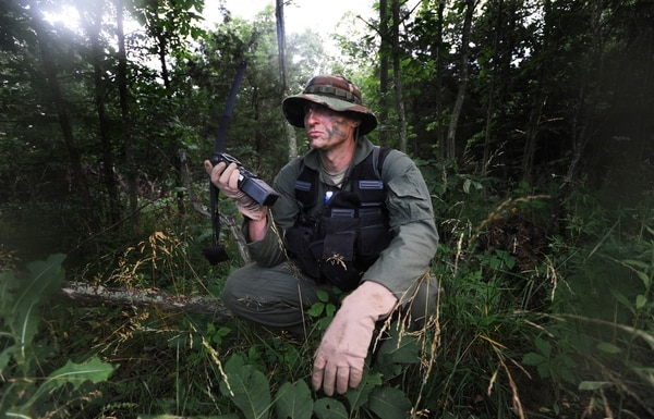 Capt. Jason Morgan, 393rd Bomb Squadron B-2 Spirit pilot, radios in his location prior to his rescue during survival training at Whiteman Air Force Base, Missouri. (Staff Sgt. Alexandra M. Boutte/Air Force)