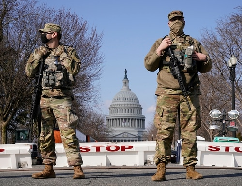 National Guard keep watch on the Capitol, Thursday, March 4, 2021, on Capitol Hill in Washington. (Jacquelyn Martin/AP)