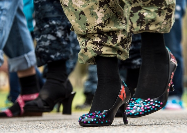 Joint Expeditionary Base Little Creek-Fort Story service members, families, and friends walk a mile in heels during the annual Walk a Mile in Her Shoes event. Walk a Mile in Her Shoes is an opportunity for men and women to raise awareness in their community about rape, sexual assault and gender violence. (U.S. Navy photo by Mass Communication Specialist 3rd Class Andrew Schneider/Released)