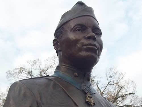 A statue of Freddie Stowers, first black American soldier in World War I to receive the Medal of Honor, stands at Anderson University in South Carolina. Stowers' award recommendation was lost for decades and the medal was finally presented to his family in 1991. His fellow soldier, Pvt. Burton Holmes, was also recommended for the Medal of Honor, but the award was downgraded. (Army)
