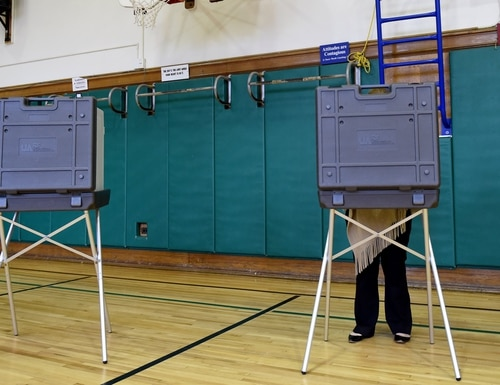 A new report is significant because security of the midterm elections was one metric that could be used to judge the success of the Trump administration's plan to become more aggressive in cyberspace, (Timothy A. Clary/AFP/Getty Images)