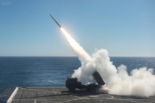 The High Mobility Artillery Rocket System (HIMARS) is fired from the flight deck of San Antonio-class amphibious transport dock ship USS Anchorage (LPD 23) on Oct. 22, 2017, during Dawn Blitz 2017. (MC2 Matthew Dickinson)