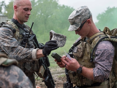 Security forces airmen conduct GPS-based land navigation during the Airmen Defender Challenge. (Air Force)