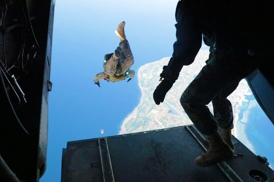 Cpl. Dustin Murphy, left, and Gunnery Sgt. Christopher Bird, right, conduct military free fall operations June 6, 2019, on Ie Shima, Okinawa, Japan. (Cpl. Ryan Harvey/Marine Corps)