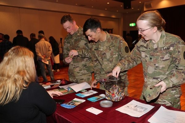 Soldiers get information on pets during the Summer Safety Day and Health Fair. Participation in summer safety trainings and campaigns is no longer mandatory. (Noriko Kudo/Army)