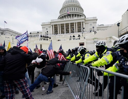 Trump supporters try to break through a police barrier, Wednesday, Jan. 6, 2021, at the Capitol in Washington. As Congress prepares to affirm President-elect Joe Biden's victory, thousands of people have gathered to show their support for President Donald Trump and his claims of election fraud. (Julio Cortez/AP)