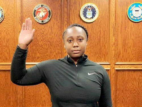 Tierney Crutcher is sworn into the U.S Navy as a Navy seaman recruit, in Memphis, Tenn., on Wednesday, Sept. 11, 2019, two days shy of her 18th birthday. (Navy Recruiting Command via AP)