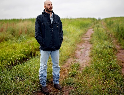 In this July 17, 2014, file photo, Michael Behenna stands on land that he helps work in Medford, Okla. (Sarah Phipps/The Oklahoman via AP, File)