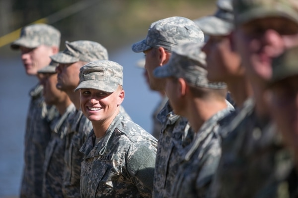 Maj. Lisa Jaster, center, stands in formation with other Rangers during an Army Ranger school graduation ceremony, Friday, Oct. 16, 2015, in Fort Benning, Ga. Jaster, who is the first Army Reserve female to graduate the Army's Ranger School, joins U.S. Army Capt. Kristen Griest and First Lt. Shaye Haver as the third female soldier to complete the school. (AP Photo/Branden Camp)