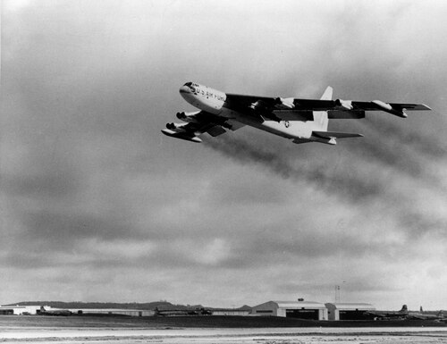 A four-engine U.S. B-52 bomber takes off from Guam for a strike against the Viet Cong in Vietnam, 2,200 miles away, in 1965 during the Vietnam War. (Air Force via AP)