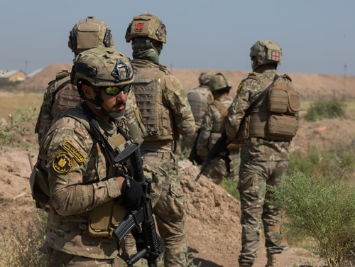 Iraqi soldiers conduct squad movement drills at Camp Taji, Iraq, July 23, 2019. Spanish and U.S. instructors train Iraqi Security Forces (ISF) in small unit tactics and techniques such as securing a helicopter landing zone, movement techniques, and crossing danger areas. (U.S. Army Reserve photo by Sgt. William Ploeg)