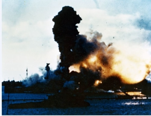 The forward magazines of the battleship Arizona explode after being hit by a Japanese bomb, 7 December 1941. Frame clipped from a color motion picture taken from on board the hospital ship Solace. (National Archives)