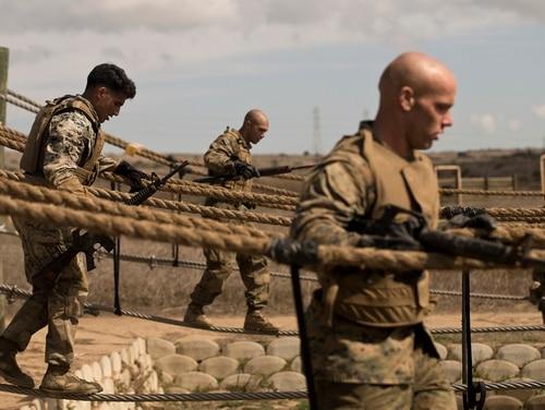 Marines walk across a rope bridge at Marine Base Camp Pendleton, California, Feb. 26, 2018. (Cpl. Erick ClarosVillalta/Marine Corps)