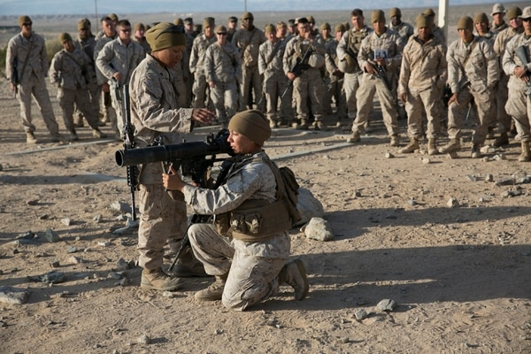 Cpl. Janelle Lopez, left, and Cpl. Maya Garnica conduct a safety brief before Marines with the Ground Combat Element Integrated Task Force participate in task assessments at Marine Corps Air Ground Combat Center Twentynine Palms in Twentynine Palms, Calif., on Saturday, April 11, 2015. The GCEITF is evaluating the integration of female Marines into artillery, infantry and mechanized MOS's. (Mike Morones/Staff)