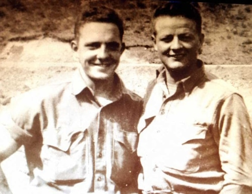 Pfc. Jack Carl Kightlinger, left, and his best friend Floyd Swift. (Photo courtesy Purple Hearts Reunited)