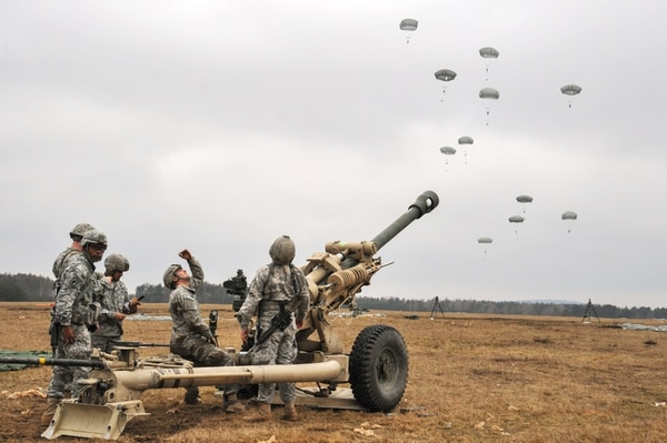 U.S. Army paratroopers, assigned to 4th Battalion, 319th Airborne Field Artillery Regiment, 173rd Airborne Brigade, get a M119 howitzer ready for combat during a heavy drop mission at the 7th Army Joint Multinational Training Command's Grafenwoehr Training Area, Germany, Feb. 25, 2015. (Visual Information Specialist Markus Rauchenberger/Army)