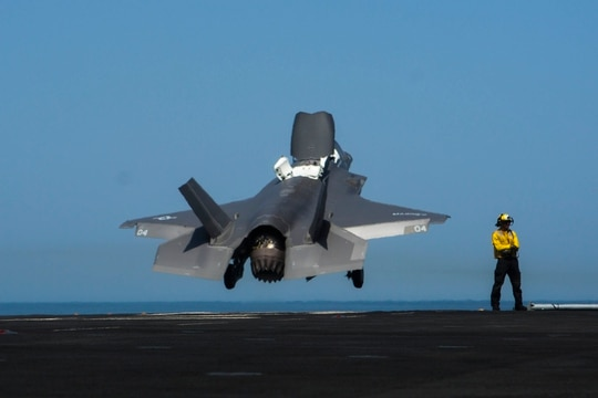 Petty Officer 3rd Class Alexander Rock launches an F-35B assigned to Marine Fighter Attack Squadron 211 from the Wasp-class amphibious assault ship Essex on Sept. 9, 2018. (Cpl. A. J. Van Fredenberg/U.S. Marine Corps)