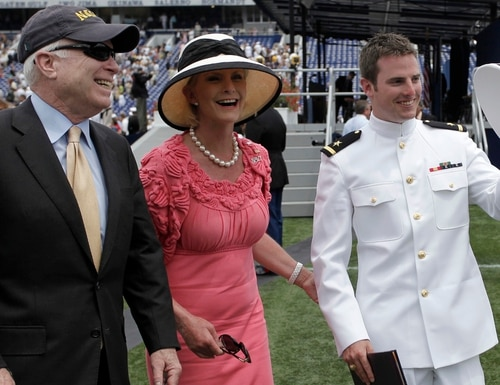 In this May 22, 2009, photo, Sen. John McCain, R-Ariz., left, and his wife, Cindy, walk with their son Jack after he graduated from the U.S. Naval Academy. (Rob Carr/AP)