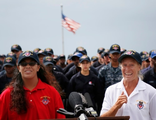 Jennifer Appel, right, and Tasha Fuiava speak on the deck of the USS Ashland at White Beach Naval Facility in Okinawa, Japan, Monday, Oct. 30, 2017. The U.S. Navy ship arrived at the American Navy base, five days after it picked up the women and their two dogs from their storm-damaged sailboat, 900 miles southeast of Japan. (Koji Ueda/AP)