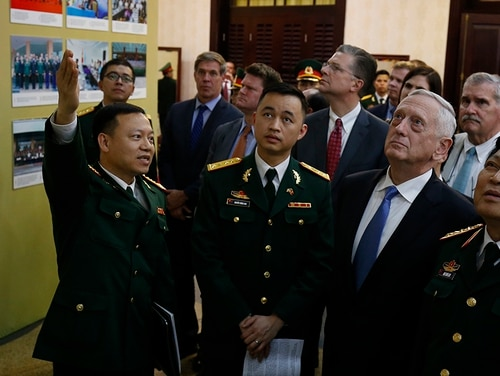 Vietnam's Defence Minister Ngo Xuan Lich (R) and Defense Secretary James Mattis attend a photo exhibition of Vietnam-US military cooperation after their meeting in Hanoi on Jan. 25, 2018. (Kham/AFP/Getty Images)