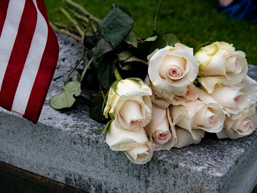 Flowers lay on a bench during a funeral at the National Memorial Cemetery of the Pacific, Honolulu. (Staff Sgt. Jamarius Fortson/Army)