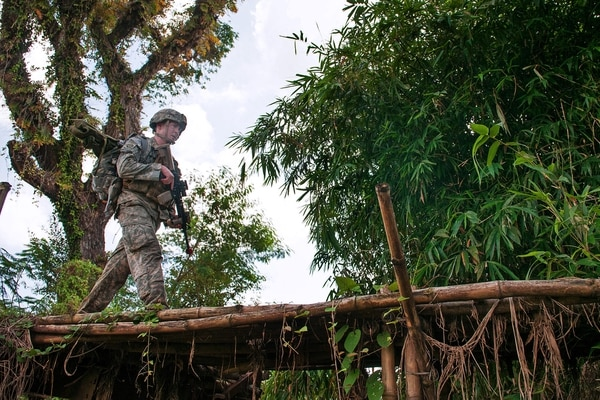 U.S. Army 1st Lt. Shane Joyce, a platoon leader with the 82nd Airborne Division's 1st Brigade Combat Team, leads a patrol across a bridge during a field training exercise with the Indonesian Army's 17th Airborne Brigade, 1st Infantry Division, June 18, 2013, West Java, Indonesia. It is part of the annual Garuda Shield exercise between the U.S. and Indonesian armies. (U.S. Army photo by Sgt. Michael J. MacLeod)
