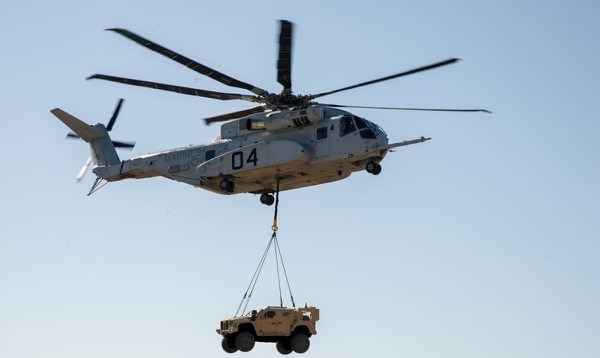 A CH-53K King Stallion lifts a Joint Light Tactical Vehicle during a demonstration, Jan. 18. Using the single point hook, the helicopter hovered up to 100 feet for approximately 10 minutes while carrying the 18,870-pound vehicle. (Navy)