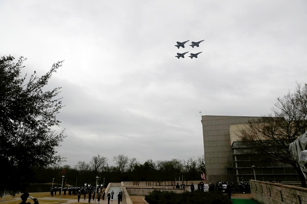 U.S. Navy planes planes fly over as the hearse carrying the casket of former President George H.W. Bush arrives at the George H.W. Bush Presidential Library and Museum Thursday, Dec. 6, 2018, in College Station, Texas. (Matt York/AP Pool)