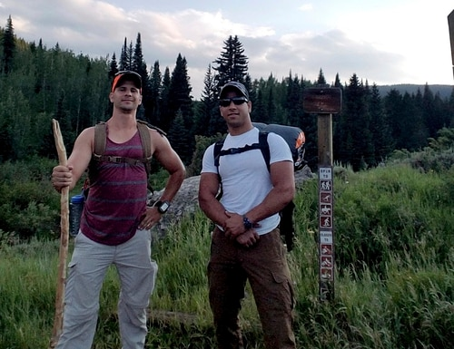 Pfc. Ali J. Alkazahg, right, poses with Trevor Reilly, left, July 7, 2017, while hiking in the Eagles Nest Wilderness of the Dillon Ranger District in Colorado. (Trevor Reilly via AP)