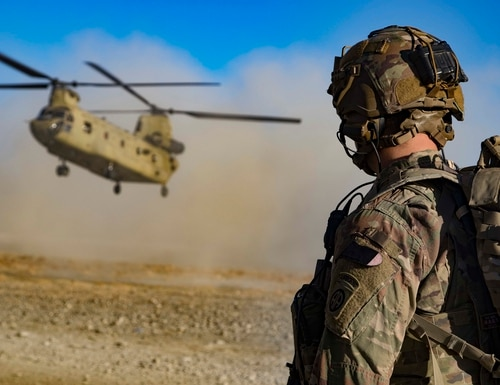 A U.S. soldier watches as a CH-47 Chinook helicopter prepares to land in preparation for the extraction of Afghan and U.S. soldiers following a key leader engagement Dec. 29, 2019, in southeastern Afghanistan. (Master Sgt. Alejandro Licea/Army)