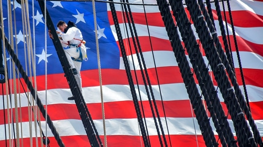 Fireman Gabriel Lupo, assigned to USS Constitution, climbs the ship's mizzenmast during 'Old Ironsides' underway commemorating the Vietnam War. In coordination with the United States of America Vietnam War Commemoration, the crew of USS Constitution hosted Vietnam veterans onboard as a thank you for their years of service and sacrifice for their country. (MC3 Casey Scoular/Navy)