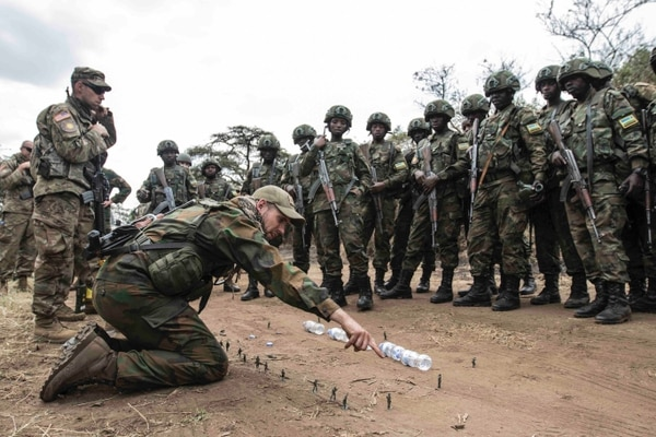 A member of the Dutch Army uses a sand table to give feedback to members of the Rwanda Defence Force following their run of convoy operations training as part of Exercise Shared Accord 2019, in Gabiro, Rwanda Aug. 23, 2019. (Sgt. Heather Doppke/Army)