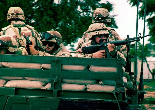 American and U.N. soldiers patrol Oct. 13, 1993, in southern Mogadishu, Somalia. (Hocine Zaourar/AFP via Getty Images)